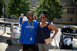 Mother and son at UK Move In posing for a photo while they wait to move into residence hall.