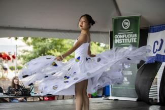 A female dancer performs onstage during Confucius Institute Day festivities.