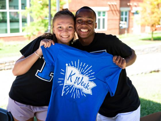 Two students with K Week Shirt